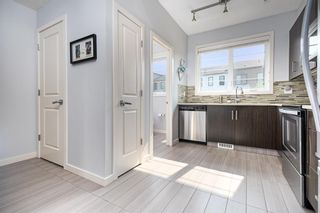 Photo 8: 393 WALDEN Drive SE in Calgary: Walden Row/Townhouse for sale : MLS®# A1126441