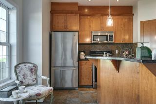 Photo 2: 2965 Peacekeepers Way SW in Calgary: Garrison Green Row/Townhouse for sale : MLS®# A1135456