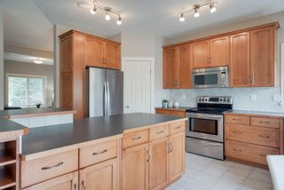Photo 8: 146 COUGARSTONE Crescent SW in Calgary: Cougar Ridge Detached for sale : MLS®# A1015703