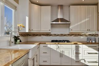 Photo 8: 7067 EDGEMONT Drive NW in Calgary: Edgemont House for sale : MLS®# C4143123