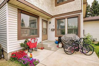 Photo 2: 1 75 TEMPLEMONT Way NE in Calgary: Temple Row/Townhouse for sale : MLS®# A1138832