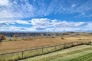 Photo 30: 4 145 Rockyledge View NW in Calgary: Rocky Ridge Apartment for sale : MLS®# A1041175