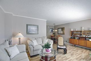 Photo 4: 787 Kingsmere Crescent SW in Calgary: Kingsland Row/Townhouse for sale : MLS®# A1108605
