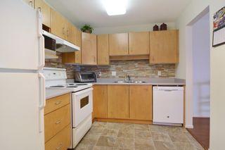 "Photo 9: 406 20239 MICHAUD Crescent in Langley: Langley City Condo for sale in ""City Grande"" : MLS®# R2062935"