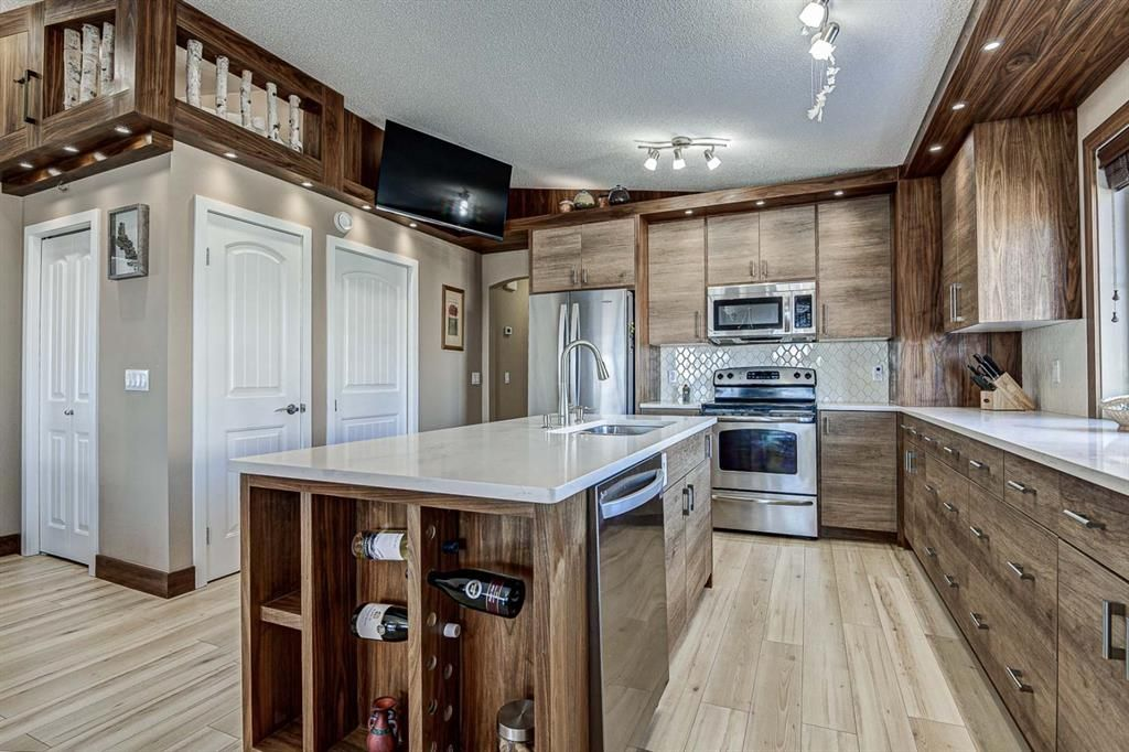 Photo 16: Photos: 230 EVERSYDE Boulevard SW in Calgary: Evergreen Apartment for sale : MLS®# A1071129