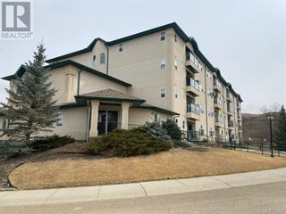 Photo 1: 207, 280 Riverside Drive E in Drumheller: Condo for sale : MLS®# A1097835
