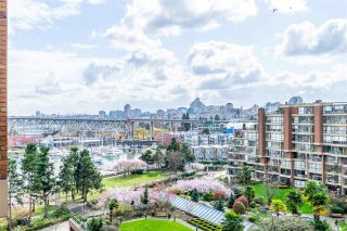 """Photo 1: 704 1450 PENNYFARTHING Drive in Vancouver: False Creek Condo for sale in """"HARBOUR COVE"""" (Vancouver West)  : MLS®# R2594220"""