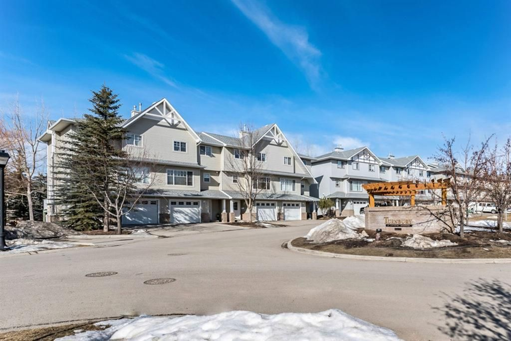 Main Photo: 6 Crystal Shores Cove: Okotoks Row/Townhouse for sale : MLS®# A1080376