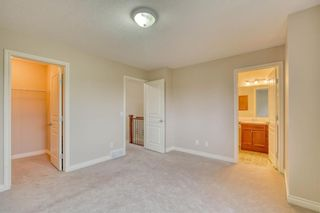 Photo 24: 66 Crystal Shores Cove: Okotoks Row/Townhouse for sale : MLS®# C4305435