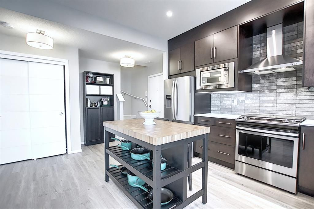 Main Photo: 201 135 Redstone Walk NE in Calgary: Redstone Apartment for sale : MLS®# A1060220