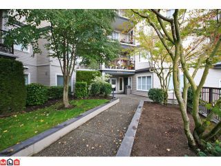 """Photo 1: 215 5765 GLOVER Road in Langley: Langley City Condo for sale in """"COLLEGE COURT"""" : MLS®# F1013966"""