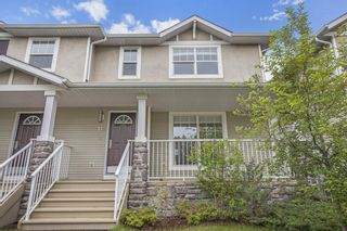 Photo 1: 37 West Springs Gate SW in Calgary: West Springs Semi Detached for sale : MLS®# A1119140