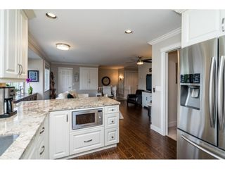 """Main Photo: 145 20391 96 Avenue in Langley: Walnut Grove Townhouse for sale in """"Chelsea Green"""" : MLS®# R2581279"""