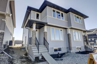 Photo 1: 132 Creekside Drive SW in Calgary: C-168 Semi Detached for sale : MLS®# A1098272