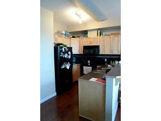 Photo 2: 1227 211 ASPEN STONE Boulevard SW in CALGARY: Aspen Woods Condo for sale (Calgary)  : MLS®# C3580149