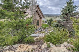 Photo 1: 39 Slopes Grove SW in Calgary: Springbank Hill Detached for sale : MLS®# A1110311