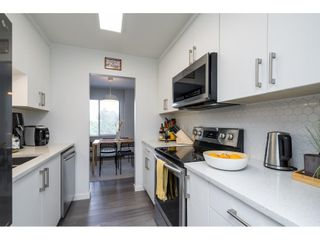 """Photo 6: 302 1720 SOUTHMERE Crescent in White Rock: Sunnyside Park Surrey Condo for sale in """"Capstan Way"""" (South Surrey White Rock)  : MLS®# R2602939"""