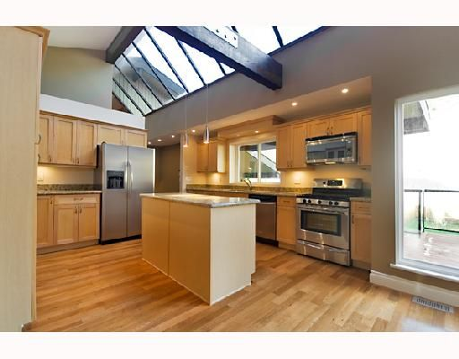 The heart of this beautiful home, the Designer Kitchen with fixed island (island has electrical power)