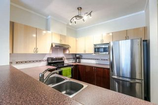 """Photo 3: 303 83 STAR Crescent in New Westminster: Queensborough Condo for sale in """"Residences by the River"""" : MLS®# R2165746"""