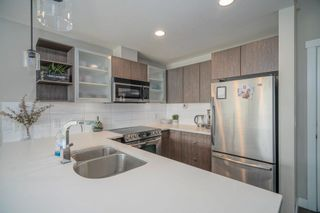 """Photo 12: 407 19936 56 Avenue in Langley: Langley City Condo for sale in """"Bearing Pointe"""" : MLS®# R2616051"""