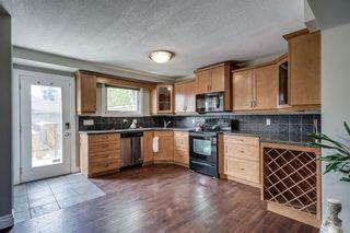 Photo 6: 2419 53 Avenue SW in Calgary: North Glenmore Park Semi Detached for sale : MLS®# C4299769