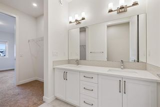 Photo 26: 12562 Crestmont Boulevard SW in Calgary: Crestmont Row/Townhouse for sale : MLS®# A1117892