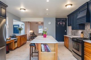 """Photo 7: 228 GIFFORD Place in New Westminster: Queens Park House for sale in """"QUEEN'S PARK"""" : MLS®# R2588400"""