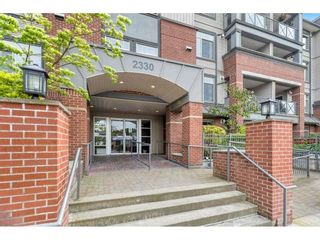 """Photo 2: 404 2330 WILSON Avenue in Port Coquitlam: Central Pt Coquitlam Condo for sale in """"SHAUGHNESSY WEST"""" : MLS®# R2588872"""
