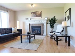 Photo 9: 772 LUXSTONE Landing SW: Airdrie House for sale : MLS®# C4016201