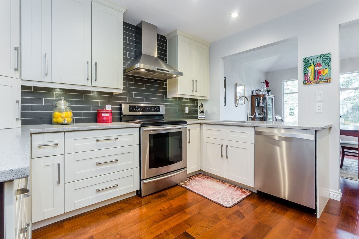 """Main Photo: 70 2500 152 Street in Surrey: King George Corridor Townhouse for sale in """"Peninsula Village"""" (South Surrey White Rock)  : MLS®# R2270791"""