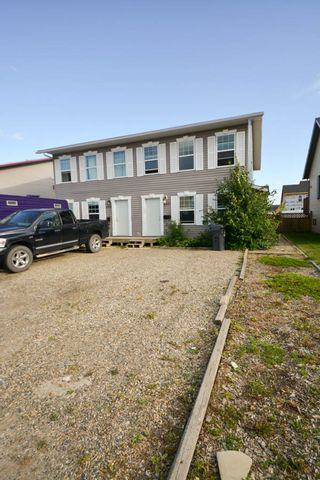 Photo 2: 7921 88 Avenue in Fort St. John: 1/2 Duplex for sale