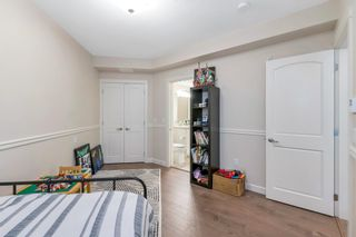 """Photo 20: 306 14588 MCDOUGALL Drive in Surrey: King George Corridor Condo for sale in """"Forest Ridge"""" (South Surrey White Rock)  : MLS®# R2596769"""