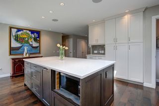 Photo 10: 131 Parkview Way SE in Calgary: Parkland Detached for sale : MLS®# A1106267