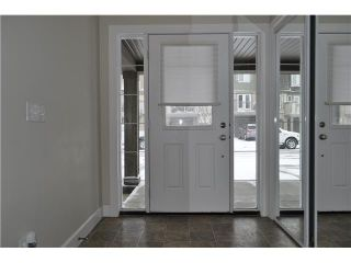 Photo 2: 118 WINDSTONE Crescent SW: Airdrie Townhouse for sale : MLS®# C3590682