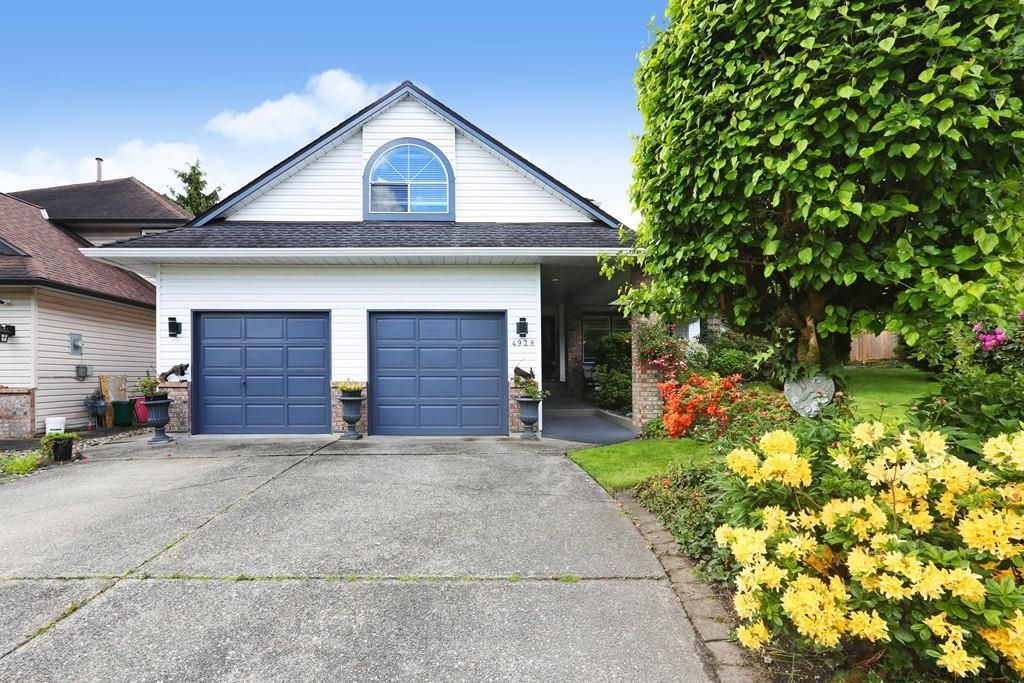 """Main Photo: 4928 196B Street in Langley: Langley City House for sale in """"High Knoll"""" : MLS®# R2610157"""