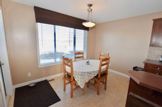 Photo 12: 784 LUXSTONE Landing SW: Airdrie House for sale : MLS®# C4160594