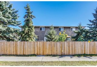 Photo 2: 11404 ELBOW Drive SW in Calgary: Southwood Multi Family for sale : MLS®# A1100297