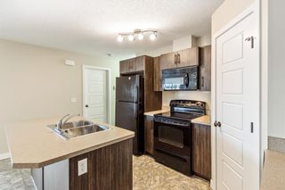 Photo 3: 9103 2781 Chinook Winds Drive SW: Airdrie Row/Townhouse for sale : MLS®# A1102621