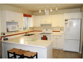 """Photo 1: 3918 INDIAN RIVER DR in North Vancouver: Indian River Condo for sale in """"HIGHGATE TERRACE"""" : MLS®# V880705"""