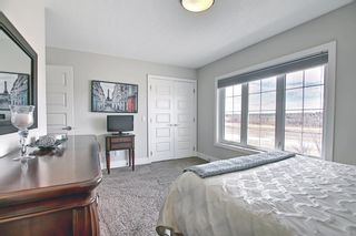 Photo 29: 444 Quarry Way SE in Calgary: Douglasdale/Glen Row/Townhouse for sale : MLS®# A1094767