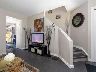 Photo 4: 55 123 Queensland Drive SE in Calgary: Queensland Row/Townhouse for sale : MLS®# A1101736