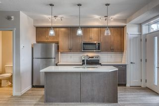 Main Photo: 12 30 Shawnee Common SW in Calgary: Shawnee Slopes Apartment for sale : MLS®# A1106401