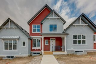 Photo 2: 249 Lucas Avenue NW in Calgary: Livingston Row/Townhouse for sale : MLS®# A1102463