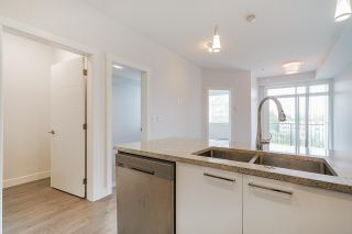 """Photo 5: 418 20696 EASTLEIGH Crescent in Langley: Langley City Condo for sale in """"The Georgia"""" : MLS®# R2574305"""