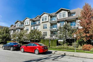 "Photo 2: 404 15323 17A Avenue in Surrey: King George Corridor Condo for sale in ""SEMIAHMOO PLACE"" (South Surrey White Rock)  : MLS®# R2308322"