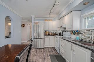 """Photo 9: 107 303 CUMBERLAND Street in New Westminster: Sapperton Townhouse for sale in """"CUMBERLAND COURT"""" : MLS®# R2604826"""