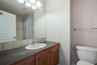 Photo 18: 8 Everridge Gardens SW in Calgary: Evergreen Row/Townhouse for sale : MLS®# A1041120