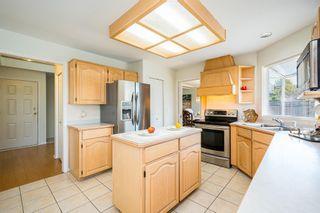 "Photo 8: 8576 142 STREET Street in Surrey: Bear Creek Green Timbers House for sale in ""Brookside"" : MLS®# R2598904"