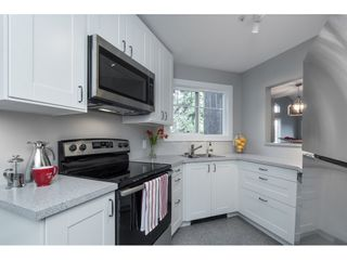 """Photo 6: 406 20288 54 Avenue in Langley: Langley City Condo for sale in """"Langley City"""" : MLS®# R2432392"""
