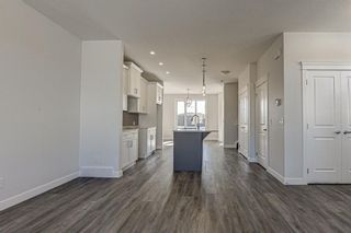 Photo 6: 136 Creekside Drive SW in Calgary: C-168 Semi Detached for sale : MLS®# A1108851